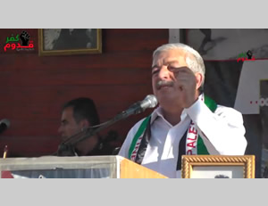 Mahmoud al-A'alul speaks at a rally in the village of Qadoum
