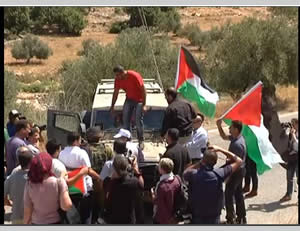 Popular committee activists confront IDF forces west of Ramallah.