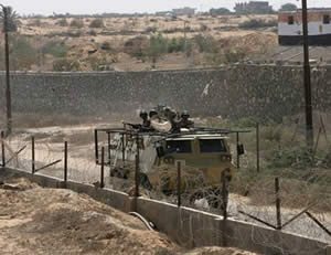 Egyptian army forces operate along the Egypt-Gaza Strip border to locate and demolish smuggling tunnels