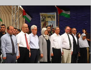 The British consul (third from right, yellow arrow)  to whose right are Mustafa Barghouti, Lila Ghanem, the governor of the Ramallah district, Jamal Muhaisen of Fatah's Central Committee, and Rami Hamdallah, Palestinian prime minister (Wafa News Agency, October 2, 2013).