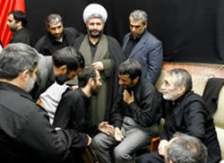 Ahmadinejad with eulogists. On the right: Mansour Arzi