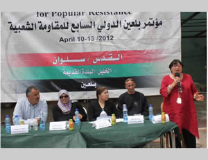 Luisa Morgantini speaks at a meeting of the seventh Bil'in conference held in the east Jerusalem neighborhood of Silwan (Silwanic.net website, April 12, 2012).