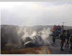 An Israeli civilian vehicle near Tekoa (Gush Etzion, south of Jerusalem) is destroyed by fire after having been attacked with a Molotov cocktail