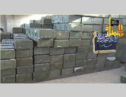 Some of the crates of weapons and ammunition seized; the black flag belongs to the Al-Nusra Front (Jalnosra.com website)