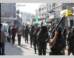 Military parade held by Hamas in the streets of Gaza City marking the first anniversary of Operation Pillar of Defense (Palinfo website, November 14, 2013).