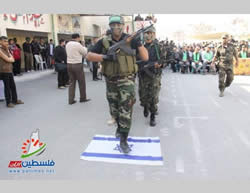 Gazan youths participating in the Al-Futuwwa Project march on Israeli flags (Filastin Al-'Aan, November 20, 2013).