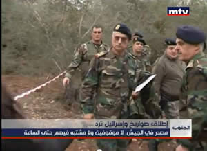 Lebanese army forces examine the area where the rockets were fired (MTV, Lebanon, December 30, 2013).
