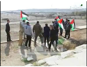Palestinian activists plant flags in preparation for erecting Canaan Village 9 near the Dead Sea (Palestinian TV, January 1, 2014).