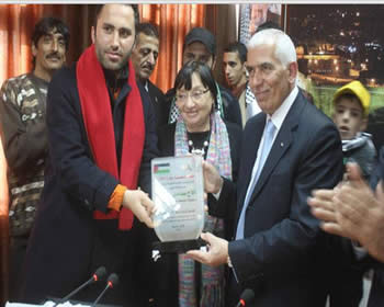 Luisa Morgantini (center), former European Parliament vice president, presents the governor of Hebron with an award for his support of what the so-called