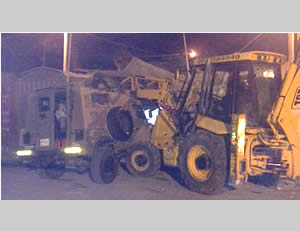 Vehicular attacks: The blade of the front loader slams into the roof of an IDF jeep (IDF Spokesman, October 17, 2013).