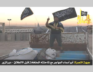 The suicide bomber known as Abu Usama al-Australi (aka Abu Usama al-Muhajir) reads his will standing on the roof of the truck he used in his suicide bombing attack.