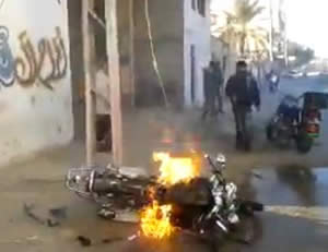 The motorbike ridden by Abdallah Salim al-Kharti after the attack  (YouTube and Filastin Al-'Aan, February 9, 2014).