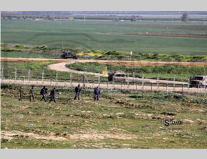 Hamas security service operatives patrol the Israel-Gaza border to keep Gazans away from the area. Opposite them are IDF forces
