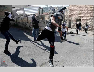 Palestinians throw stones at the Israeli security forces in east Jerusalem