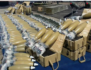 122mm mortar shells manufactured in Iran. Right: M-302 rockets manufactured in Syria  (IDF Spokesman, March 10, 2014).