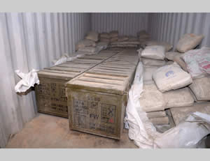The crates of weapons hidden underneath sacks of cement (IDF Spokesman, March 8, 2014).