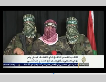 Hamas military-terrorist wing holds a press conference to discuss the discovery of the tunnel (Al-Aqsa TV, March 21, 2014).