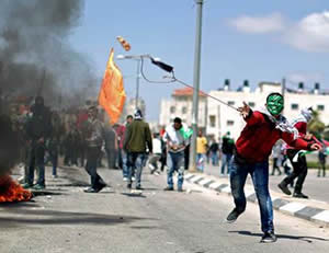 Palestinians throw stones at IDF forces near the Ofer jail (Wafa News Agency, April 4, 2014).
