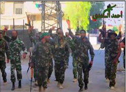 Hezbollah operatives cerebrate their victory after the takeover of the city of Yabrud (YouTube, March 16, 2014).