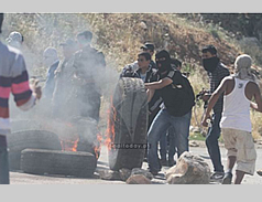 Palestinians confront the Israeli security forces near the Ofer jail during a Nakba Day riot (Paltoday.ps, May 15, 2014).