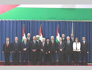 Some of the members of the Palestinian unity government at the swearing in ceremony in Mahmoud Abbas' office in Ramallah. Five ministers from the Gaza Strip did not attend (Paltoday.ps, June 2, 2014)