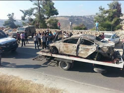 The burned-out vehicle assumed to be linked to the abduction (Paltimes.net, June 13, 2014).