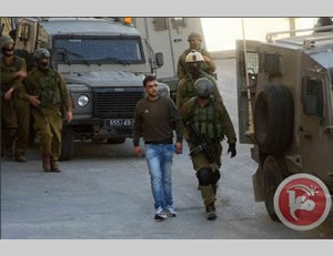 Israel security forces detain a wanted Palestinian in the Hebron sector