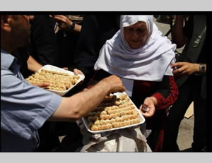 Pastries handed out in the Gaza Strip at a protest tent erected in support of the administrative detainees holding a hunger strike in Israeli jails