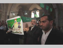 Ismail Haniya helps carry the coffin of one of the five Hamas terrorists killed in the tunnel explosion