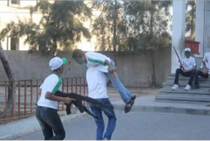 Simulating blowing up a motorbike and abducting an Israeli (Facebook page of the summer camp, June 12, 2014)