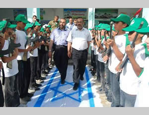 Indoctrinating hatred of Israel: important visitors at the Khan Yunis summer camp are welcomed with a military