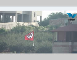 A flag with a Nazi swastika flies in Beit Umar, near Hebron (Photo by Avraham Weiss for Tazpit.org.il, July 6, 2014).