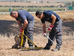 Israel Police Force demolitions specialists deal with rocket fragments (Facebook page of the Israel Police Force)