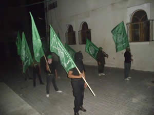 Nighttime military parade of the Izz al-Din al-Qassam Brigades, the military wing of Hamas, which began near the Al-Farouq Mosque