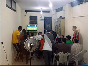 Boys watching World Cup games at the Al-Farouq Mosque. The word