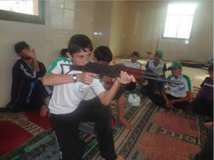 Children and teenagers undergoing weapons training at mosques during 2014 summer camps