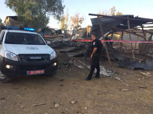 A rocket that hit a Bedouin village in the Negev. Two young girls were wounded, one of them critically (Facebook page of the Israel Police Force, July 15, 2014).