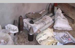 Weapons and raw materials for the manufacture of explosives found in a residential building. The bags (marked in Hebrew) contain table salt, used to manufacture explosives