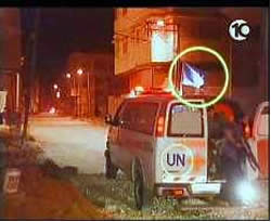 A UNRWA ambulance evacuates a wounded Palestinian and terrorist operatives from the combat zone (Photo courtesy of Israeli Channel 10 TV, May 11, 2004).