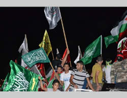 A solidarity march held in Tubas (with PIJ, PFLP, Fatah and Hamas flags) (Paltimes.net, July 25, 2014).