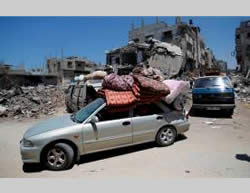 Shejaiya families return to their houses to remove possessions (Wafa.ps, August 1, 2014).