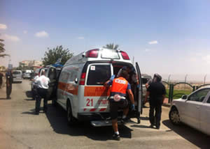 Evacuating the wounded security guard to a hospital (Mdais.org, August 5, 2014).