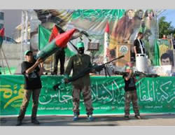 Hamas operatives holding models of weapons used during Operation Protective Edge.