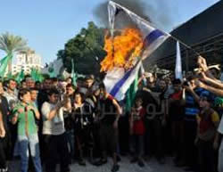 Burning an Israeli flag at a rally in Gaza (Gaza Alan, August 26 and 27, 2014).