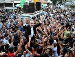 Hamas officials Fawzi Barhoum and Sami Abu Zuhri hoisted on the shoulders of civilians during victory celebrations in Gaza.