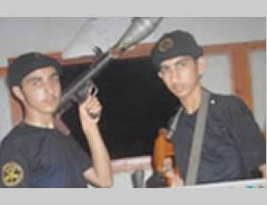 Iyad Shurab (left) and his brother Wassim Shurab (right) in the uniform of the PIJ Al-Quds Battalions, both armed (saraya.ps). The picture was taken at a time when they were adolescents, further example of the recruitment of adolescents into the ranks of terrorist organizations in the Gaza Strip.