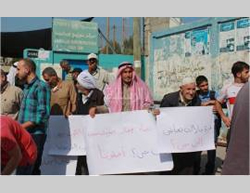 Residents of the northern Gaza Strip demonstrate in front of the UNRWA offices in Jabaliya to protest the delay of the beginning of rebuilding activities