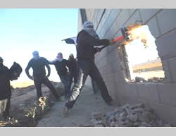 Popular Resistance Committees operatives vandalize the security forces  (PALDF, November 8, 2014).