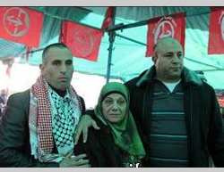 Jamal Abu Jaml (left) on his release from prison in Israel. There are PFLP flags hung in the background (Panet.co.il, January 4, 2014).