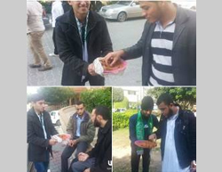 Palestinians in the Gaza Strip hand out candy and cookies to celebrate the terrorist attack in Jerusalem (Facebook page of QudsN, November 18, 2014).